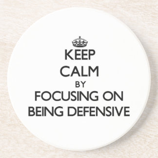 Keep Calm by focusing on Being Defensive Drink Coaster