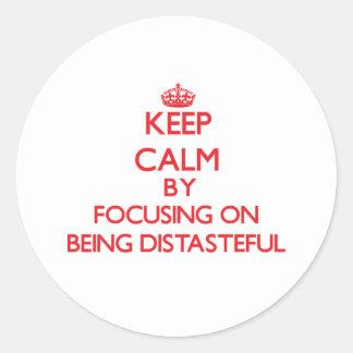 Keep Calm by focusing on Being Distasteful Sticker