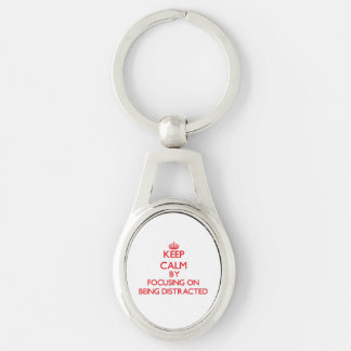 Keep Calm by focusing on Being Distracted Key Chain