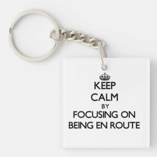 Keep Calm by focusing on BEING EN ROUTE Keychains