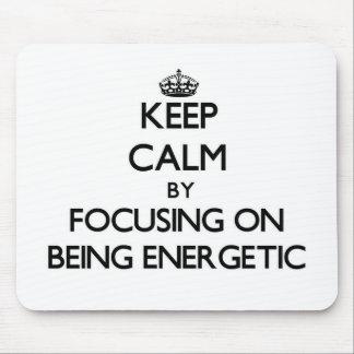 Keep Calm by focusing on BEING ENERGETIC Mousepad