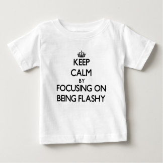 Keep Calm by focusing on Being Flashy Tee Shirts