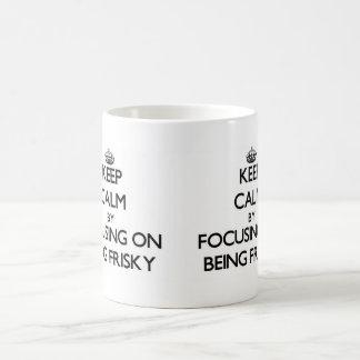 Keep Calm by focusing on Being Frisky Mug