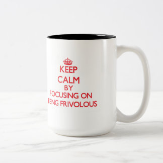 Keep Calm by focusing on Being Frivolous Two-Tone Coffee Mug