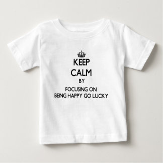 Keep Calm by focusing on Being Happy-Go-Lucky Tees