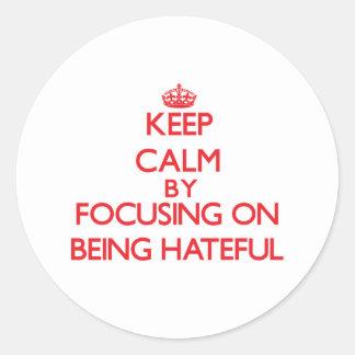 Keep Calm by focusing on Being Hateful Round Sticker