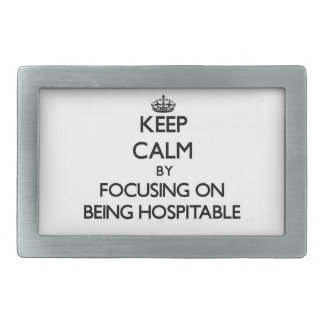 Keep Calm by focusing on Being Hospitable Belt Buckles