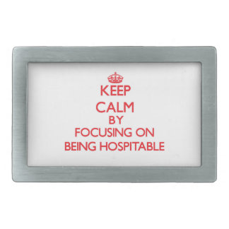 Keep Calm by focusing on Being Hospitable Belt Buckle
