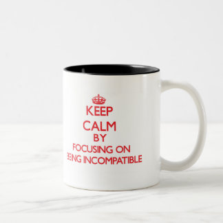Keep Calm by focusing on Being Incompatible Two-Tone Coffee Mug