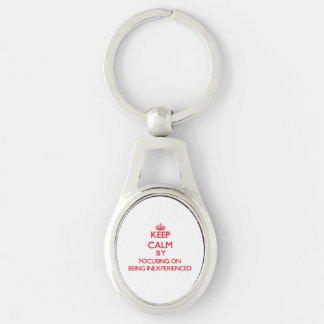 Keep Calm by focusing on Being Inexperienced Silver-Colored Oval Metal Keychain