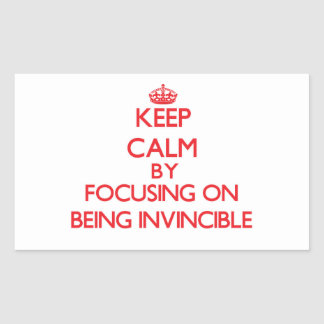 Keep Calm by focusing on Being Invincible Rectangular Sticker