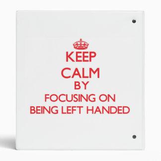 Keep Calm by focusing on Being Left Handed Vinyl Binder