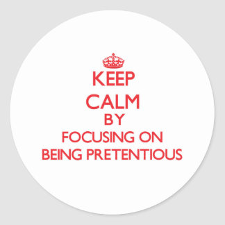 Keep Calm by focusing on Being Pretentious Stickers