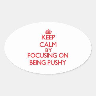 Keep Calm by focusing on Being Pushy Sticker