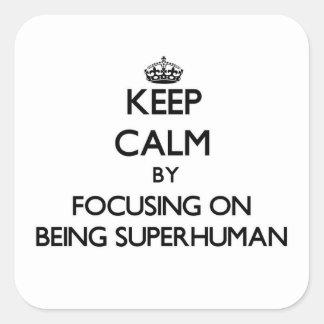 Keep Calm by focusing on Being Superhuman Sticker