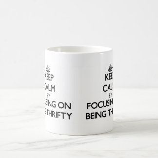 Keep Calm by focusing on Being Thrifty Mug
