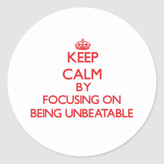 Keep Calm by focusing on Being Unbeatable Classic Round Sticker