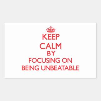 Keep Calm by focusing on Being Unbeatable Rectangular Sticker