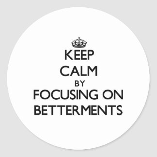 Keep Calm by focusing on Betterments Classic Round Sticker