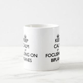 Keep Calm by focusing on Biplanes Mugs