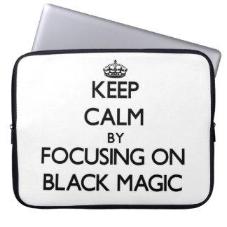 Keep Calm by focusing on Black Magic Laptop Sleeves