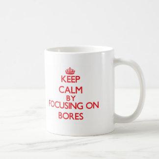Keep Calm by focusing on Bores Classic White Coffee Mug