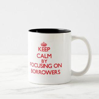 Keep Calm by focusing on Borrowers Two-Tone Coffee Mug