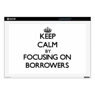 Keep Calm by focusing on Borrowers Laptop Skin