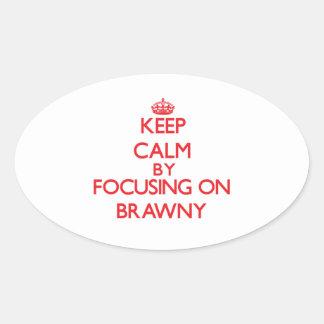 Keep Calm by focusing on Brawny Oval Sticker