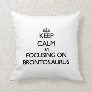 Keep Calm by focusing on Brontosaurus Throw Pillows