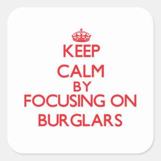 Keep Calm by focusing on Burglars Square Sticker