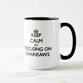 Keep Calm by focusing on Chainsaws Mug