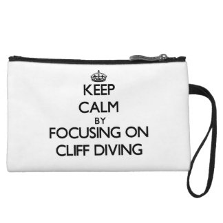 Keep Calm by focusing on Cliff Diving Wristlet Purses