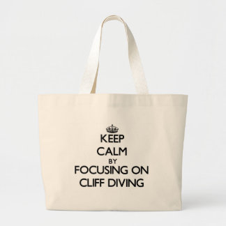 Keep Calm by focusing on Cliff Diving Tote Bag