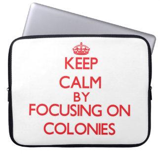 Keep Calm by focusing on Colonies Laptop Sleeves