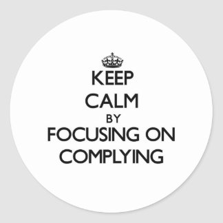 Keep Calm by focusing on Complying Round Stickers