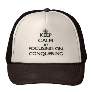 Keep Calm by focusing on Conquering Trucker Hat