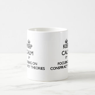 Keep Calm by focusing on Conspiracy Theories Classic White Coffee Mug