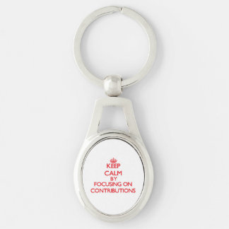 Keep Calm by focusing on Contributions Silver-Colored Oval Metal Keychain