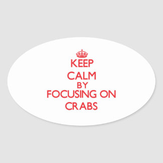 Keep Calm by focusing on Crabs Oval Stickers