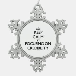 Keep Calm by focusing on Credibility Snowflake Pewter Christmas Ornament