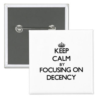 Keep Calm by focusing on Decency Pinback Buttons