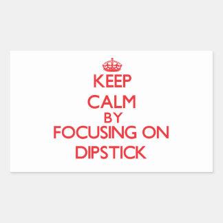 Keep Calm by focusing on Dipstick Rectangular Stickers