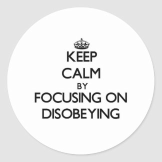 Keep Calm by focusing on Disobeying Round Stickers