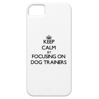 Keep Calm by focusing on Dog Trainers iPhone 5 Cover