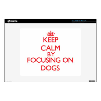 """Keep calm by focusing on Dogs 12"""" Laptop Skins"""