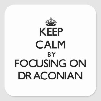Keep Calm by focusing on Draconian Sticker