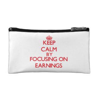 Keep Calm by focusing on EARNINGS Cosmetic Bags