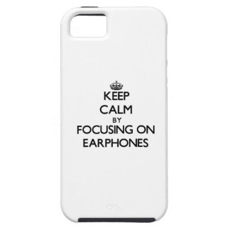 Keep Calm by focusing on EARPHONES iPhone 5 Covers