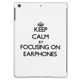 Keep Calm by focusing on EARPHONES iPad Air Covers